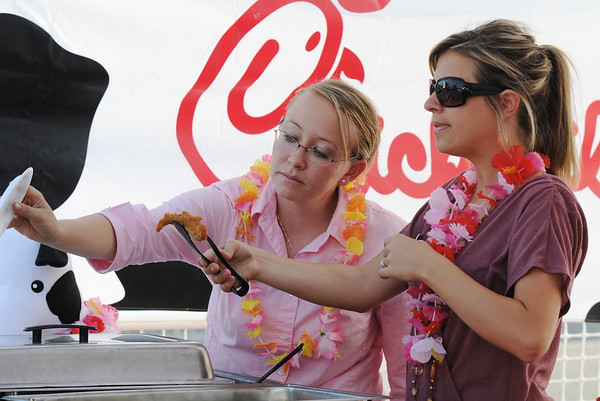 Beth Jensen, left, and Jessica Laws with Chick-fil-A serve food during the Broomfield Community Foundation's 2009 Broomfield BASH at the Beach fundraiser held at Sill-TerHar Motors on Saturday.<br /> <br /> July 18, 2009<br /> staff photo/David Jennings
