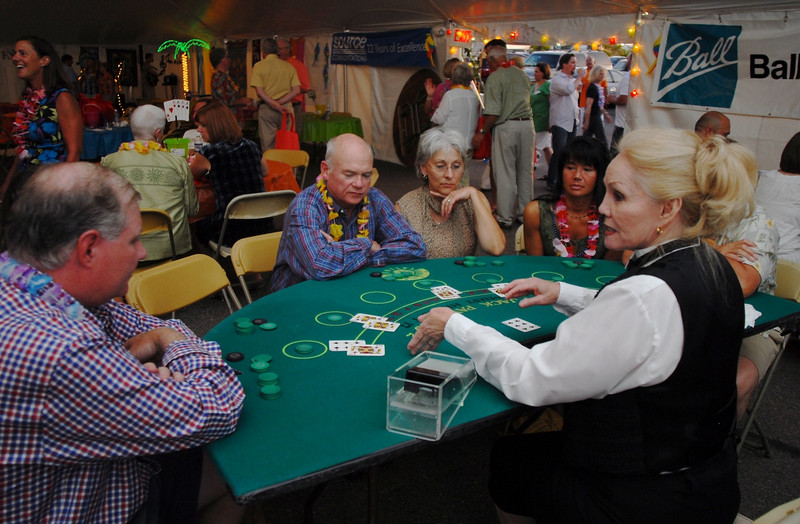 Participants play Black Jack during the Broomfield Community Foundation's 2009 Broomfield BASH at the Beach fundraiser held at Sill-TerHar Motors on Saturday.<br /> <br /> July 18, 2009<br /> staff photo/David Jennings