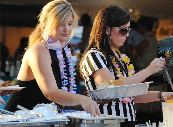 Angela Palinckx, left, and Callie Duggan, with Benders Bar and Grill, get ready to serve participants at  the Broomfield Community Foundation's 2009 Broomfield BASH at the Beach fundraiser held at Sill-TerHar Motors on Saturday.<br /> <br /> July 18, 2009<br /> staff photo/David Jennings