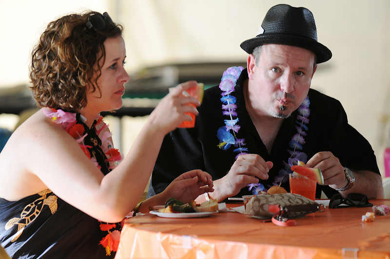 Dr. Kara Bishop, left, and Jim Montgomery partake in the food and drink during the Broomfield Community Foundation's 2009 Broomfield BASH at the Beach fundraiser held at Sill-TerHar Motors on Saturday.<br /> <br /> July 18, 2009<br /> staff photo/David Jennings
