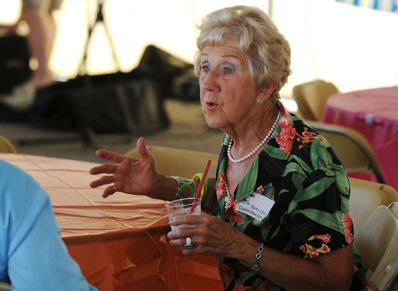Betty Cothern chats with friends during the Broomfield Community Foundation's 2009 Broomfield BASH at the Beach fundraiser held at Sill-TerHar Motors on Saturday.<br /> <br /> July 18, 2009<br /> staff photo/David Jennings