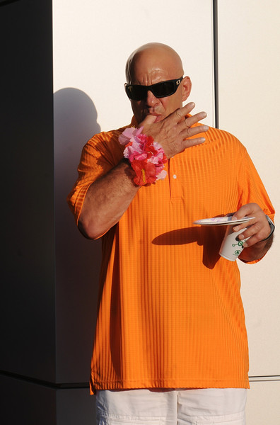 Al Pallone licks his fingers while sampling food during the Broomfield Community Foundation's 2009 Broomfield BASH at the Beach fundraiser held at Sill-TerHar Motors on Saturday.<br /> <br /> July 18, 2009<br /> staff photo/David Jennings