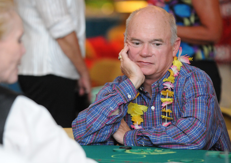 Dan Eberhart watches the cards at the Black Jack Table during the Broomfield Community Foundation's 2009 Broomfield BASH at the Beach fundraiser held at Sill-TerHar Motors on Saturday.<br /> <br /> July 18, 2009<br /> staff photo/David Jennings