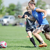 Charlee Eigenberg, 14, right, and Rachel Himyak, 13, move to the ball during the Broomfield Blast technical touch camp at the Broomfield County Commons Park on Wednesday.<br /> <br /> July 22,2009<br /> staff photo/David Jennings