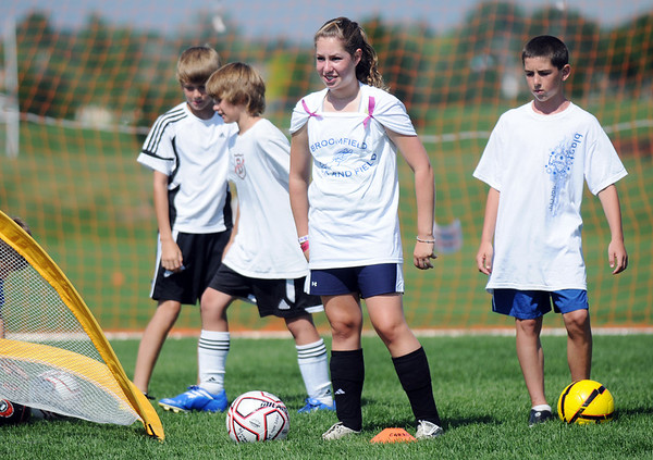 Claire Carpenter, 12, center, waits her turn to defend the ball during the Broomfield Blast technical touch camp at the Broomfield County Commons Park on Wednesday.<br /> <br /> July 22,2009<br /> staff photo/David Jennings
