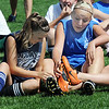 Evee Arnsdorf, 14, left, and Sara Barton, 15, look at Charlee Eigenberg,14, shoes during a break  at the Broomfield Blast technical touch camp at the Broomfield County Commons Park on Wednesday.<br /> <br /> July 22,2009<br /> staff photo/David Jennings