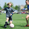 Rachel Himyak, 13, left, moves the ball as Charlee Eigenberg, 14, defends during the Broomfield Blast technical touch camp at the Broomfield County Commons Park on Wednesday.<br /> <br /> July 22,2009<br /> staff photo/David Jennings