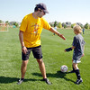 Assistant coach Will Conolly, left,  shows how Rachel Himyak, 13,  should move around him during the Broomfield Blast technical touch camp at the Broomfield County Commons Park on Wednesday.<br /> <br /> July 22,2009<br /> staff photo/David Jennings