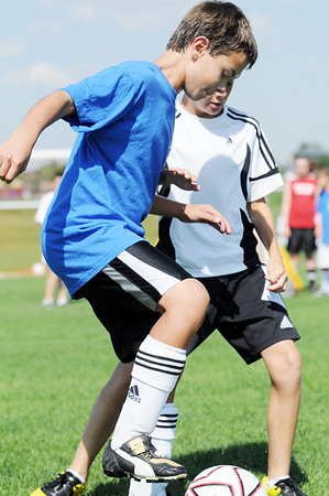 Justin Hamm, 11, left, tries to get the ball past Matt Bausch, 11,  during the Broomfield Blast technical touch camp at the Broomfield County Commons Park on Wednesday.<br /> <br /> July 22,2009<br /> staff photo/David Jennings