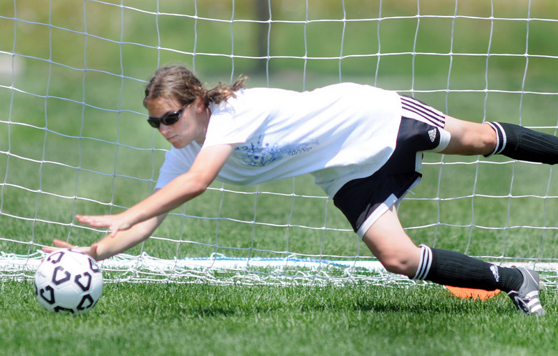 Jessi Gaisbauer, 14, dives for the ball during keeper training at the Broomfield Blast technical touch camp at the Broomfield County Commons Park on Wednesday.<br /> <br /> July 22,2009<br /> staff photo/David Jennings