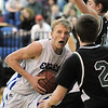 Dakota Smith,  Broomfield drives the ball to the basket against D'Evelyn during Friday's 2nd round of the state 4A boys playoffs at Broomfield.<br /> February 25, 2011<br /> staff photo/David R. Jennings