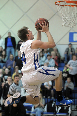 Aric Kaiser,  Broomfield, leaps to the basket against D'Evelyn during Friday's 2nd round of the state 4A boys playoffs at Broomfield.<br /> February 25, 2011<br /> staff photo/David R. Jennings