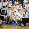 Aric Kaiser, Broomfield dribbles the ball downcourt against D'Evelyn during Friday's 2nd round of the state 4A boys playoffs at Broomfield.<br /> February 25, 2011<br /> staff photo/David R. Jennings