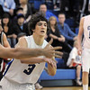 Nick Ongarato, Broomfield passes the ball away from D'Evelyn during Friday's 2nd round of the state 4A boys playoffs at Broomfield.<br /> February 25, 2011<br /> staff photo/David R. Jennings