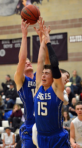 Broomfield's Evan Kihn and Dan Perse rebound the ball against Silver Creek during Friday's game at Silver Creek High. January 11, 2013 staff photo/ David R. Jennings