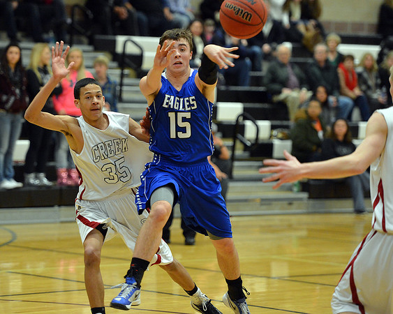 Broomfield's Evan Kihn passes the ball against Silver Creek's Kolton Bachman during Friday's game at Silver Creek High.<br /> January 11, 2013<br /> staff photo/ David R. Jennings