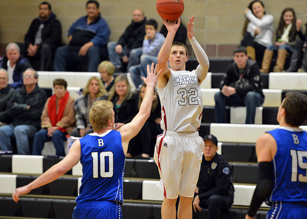 Silver Creek's Luke Goforth shoots the ball over Broomfield's Dan Perse during Friday's game at Silver Creek High.<br /> January 11, 2013<br /> staff photo/ David R. Jennings