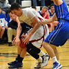 Silver Creek's  Trey Fleming fights for  the ball to Broomfield's Parker Erickson during Friday's game at Silver Creek High.<br /> January 11, 2013<br /> staff photo/ David R. Jennings