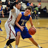 Broomfield's Spenser Reeb drives the ball against Silver Creek's Luke Goforth during Friday's game at Silver Creek High.<br /> January 11, 2013<br /> staff photo/ David R. Jennings