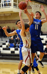 Broomfield's Spenser Reeb, right, and Alec McLain break up a shot by  Silver Creek's Zane Lindsey during Friday's game at Silver Creek High. January 11, 2013 staff photo/ David R. Jennings