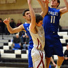 Broomfield's Spenser Reeb, right, and Alec McLain break up a shot by  Silver Creek's Zane Lindsey during Friday's game at Silver Creek High.<br /> January 11, 2013<br /> staff photo/ David R. Jennings