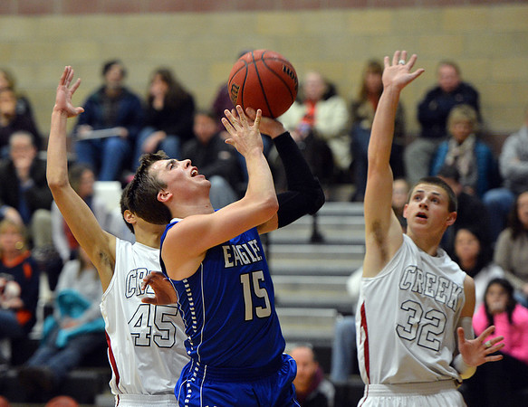 Broomfield's Evan Kihn shoots the ball past Silver Creek's Tyrone White and Luke Goforth during Friday's game at Silver Creek High.<br /> January 11, 2013<br /> staff photo/ David R. Jennings