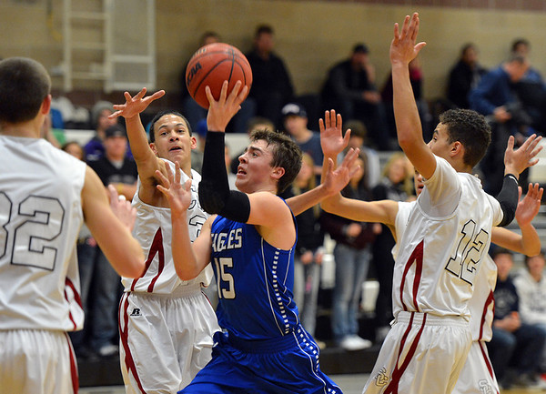 Broomfield's Evan Kihn takes the ball to the basket against Silver Creek during Friday's game at Silver Creek High.<br /> January 11, 2013<br /> staff photo/ David R. Jennings