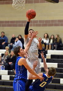 Broomfield's Silver Creek's Trey Fleming shoots the ball over Broomfield's Spenser Reeb and Chad Jukkala during Friday's game at Silver Creek High. January 11, 2013 staff photo/ David R. Jennings