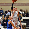 Broomfield's Silver Creek's Trey Fleming shoots the ball over Broomfield's Spenser Reeb and Chad Jukkala during Friday's game at Silver Creek High.<br /> January 11, 2013<br /> staff photo/ David R. Jennings