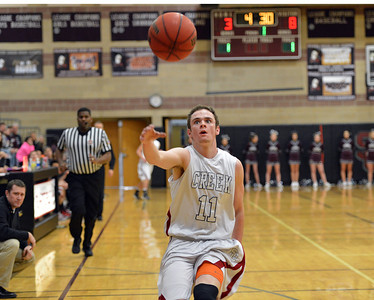 Silver Creek's Zane Lindsey reaches for the ball during Friday's game against Broomfield at Silver Creek High. January 11, 2013 staff photo/ David R. Jennings