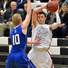 Silver Creek's Luke Goforth prepares to pass the ball over Broomfield's Dan Perse during Friday's game at Silver Creek High.<br /> January 11, 2013<br /> staff photo/ David R. Jennings