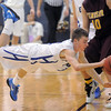 Broomfield's Austin Wood leaps to catch a loose ball from  Windsor's Aaron Schmidt during the Class 4A great eight game at the Colorado School of Mines on Saturday. <br /> March 5, 2011<br /> staff photo/David R. Jennings