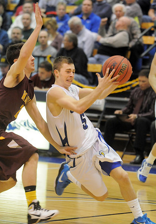 Broomfield's Austin Wood drives the ball against Windsor's Austin Geuke during the Class 4A great eight game at the Colorado School of Mines on Saturday.<br /> March 5, 2011<br /> staff photo/David R. Jennings
