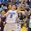Broomfield's Austin Woods goes to the basket past Windsor's Austin Geuke during the Class 4A great eight game at the Colorado School of Mines on Saturday.<br /> March 5, 2011<br /> staff photo/David R. Jennings