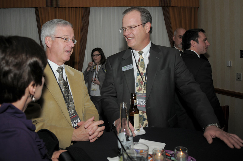 Brian Hall, right visits with members during the Broomfield Chamber of Commerce annual dinner at the Renaissance Boulder Flatiron Hotel on Thursday.<br /> <br /> January 27, 2011<br /> staff photo/David R. Jennings