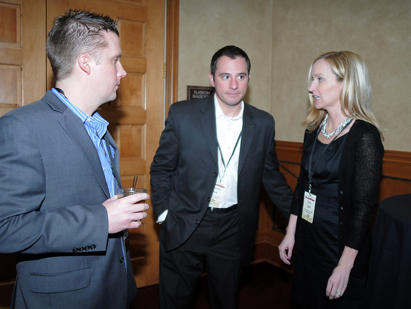 Dustin Dolan, left, chats with Damon and Jean Bell during the Broomfield Chamber of Commerce annual dinner at the Renaissance Boulder Flatiron Hotel on Thursday.<br /> <br /> January 27, 2011<br /> staff photo/David R. Jennings