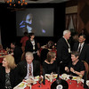 Videos of rock bands play in the back ground during the Broomfield Chamber of Commerce annual dinner at the Renaissance Boulder Flatiron Hotel on Thursday.<br /> <br /> January 27, 2011<br /> staff photo/David R. Jennings
