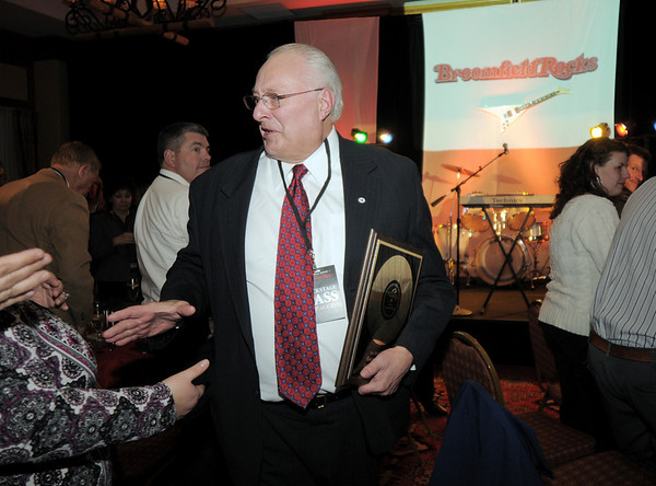 George Di Cero, manager of the City and County of Broomfield, is congratulated by audience members after being presented with the Rock Stars in Broomfield award during the Broomfield Chamber of Commerce annual dinner at the Renaissance Boulder Flatiron Hotel on Thursday.<br /> <br /> January 27, 2011<br /> staff photo/David R. Jennings