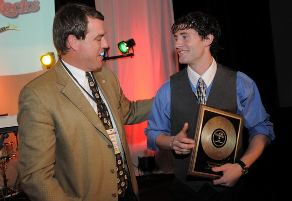 Mike Bohn, left, presents the Rock Stars in Broomfield award to Nate Terry at the Broomfield Chamber of Commerce annual dinner at the Renaissance Boulder Flatiron Hotel on Thursday.<br /> <br /> January 27, 2011<br /> staff photo/David R. Jennings