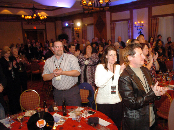 The audience gives a standing ovation to Chuck Morris during the Broomfield Chamber of Commerce annual dinner at the Renaissance Boulder Flatiron Hotel on Thursday.<br /> <br /> January 27, 2011<br /> staff photo/David R. Jennings