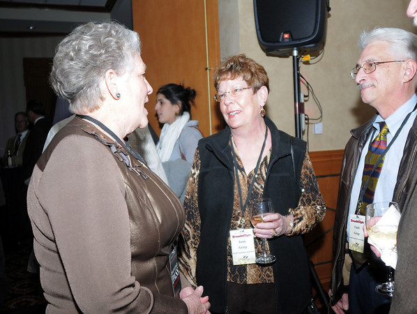Martha Derda chats with Joan and Clark Griep at the Broomfield Chamber of Commerce annual dinner on Thursday.