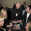 Dave Kennedy, center, with the Renaissance Boulder Flatiron Hotel, visits with chamber members  during the Broomfield Chamber of Commerce annual dinner at the Renaissance Boulder Flatiron Hotel on Thursday.<br /> <br /> January 27, 2011<br /> staff photo/David R. Jennings
