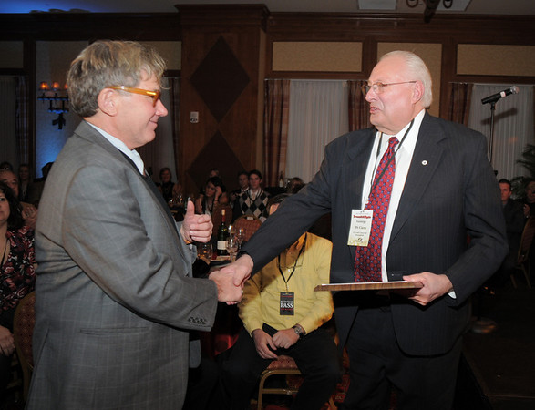 Chuck Morris, left, is presented with a special Rock Stars in Broomfield award by George Di Cerro, manger of the City and County of Broomfield,  at the Broomfield Chamber of Commerce annual dinner at the Renaissance Boulder Flatiron Hotel on Thursday.<br /> <br /> January 27, 2011<br /> staff photo/David R. Jennings