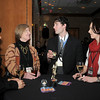 Melissa Boyer, left, Anne Collins chat with Nate Terry ad Elizabeth Lindmier during the Broomfield Chamber of Commerce annual dinner at the Renaissance Boulder Flatiron Hotel on Thursday.<br /> <br /> January 27, 2011<br /> staff photo/David R. Jennings