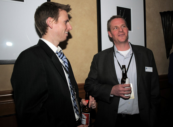 Dave Pigott, left, chats with Todd Schumacher during the Broomfield Chamber of Commerce annual dinner at the Renaissance Boulder Flatiron Hotel on Thursday.<br /> <br /> January 27, 2011<br /> staff photo/David R. Jennings
