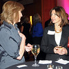 Lisa Licata, left, chats with Shelley Slater during the Broomfield Chamber of Commerce annual dinner at the Renaissance Boulder Suites Hotel on Friday.<br />  <br /> January 22, 2010<br /> Staff photo/David R. Jennings