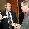 Dave Urbach, left, talks with Randy Ahrens during the Broomfield Chamber of Commerce annual dinner at the Renaissance <br /> Boulder Suites Hotel on Friday.<br />  <br /> January 22, 2010<br /> Staff photo/David R. Jennings
