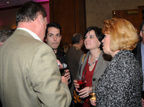 Mike and Karen McDevitt, center, engage in conversation with Bill and Marlene Duerre during the Broomfield Chamber of Commerce annual dinner at the Renaissance Boulder Suites Hotel on Friday.<br />  <br /> January 22, 2010<br /> Staff photo/David R. Jennings
