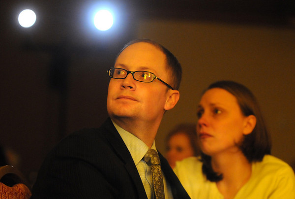 Brett Backer, left, and his wife Kathleen listen to the speech given by Patrick Ireland, managing director with Northwestern Mutual in Broomfield and survivor of the Columbine High school shootings, during the Broomfield Chamber of Commerce annual dinner at the Renaissance Boulder Suites Hotel on Friday.<br />  <br /> January 22, 2010<br /> Staff photo/David R. Jennings