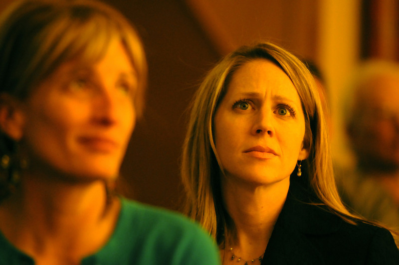 Molly Kemmer, right, and Kellie Audley listen to the speech given by Patrick Ireland, managing director with Northwestern Mutual in Broomfield and survivor of the Columbine High school shootings, during the Broomfield Chamber of Commerce annual dinner at the Renaissance Boulder Suites Hotel on Friday.<br />  <br /> January 22, 2010<br /> Staff photo/David R. Jennings
